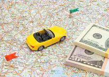 Sport car and money on map Royalty Free Stock Photo