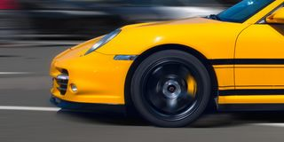 Sport car in motion. German luxury sports car in motion Royalty Free Stock Image