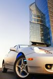 Sport car with office building. And clear blue sky behind it Royalty Free Stock Photos