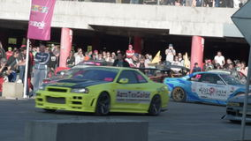 Sport car race starts. NOVOSIBIRSK, RUSSIA - JUNE 03, 2016: Cars starting race on the track. Drifting competition stock video footage