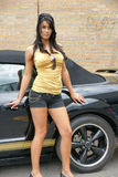 Sport car sexy girl. Beautiful fashion model in standing next to a black sports car Stock Image