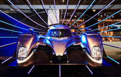 Sport car in a show room. Silver-blue sport car in a show room, among color lights Royalty Free Stock Images