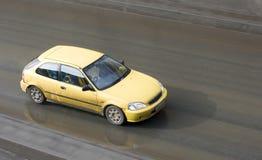 Sport car speed. A sport car speeds fast Stock Images