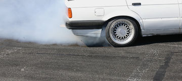 Sport car wheel drifting Royalty Free Stock Photos