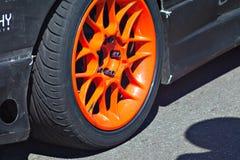 Sport car wheel. Sport car orange wheel on the road Stock Photos