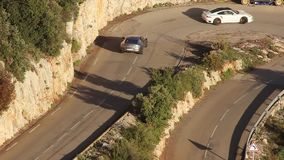 Sport Cars on a Hairpin Turn on the French Alps Road stock video footage
