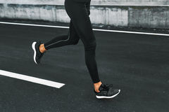 Sport. Close Up Of Male Legs Running On Road Outdoors. Sport. Close Up Of Sporty Male Legs In Sportwear And Sneakers Running On Road. Healthy Active Athletic Stock Images