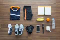Sport clothes and accessories on a wooden background Royalty Free Stock Photos