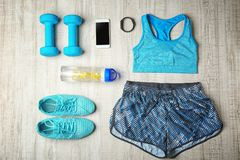 Sport clothes and equipment. On wooden background royalty free stock photo