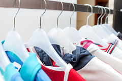 Sport clothes on hangers Stock Photo
