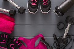 Sport clothing and equipment top view, copy space. Set of new fitness outfit for two, active lifestyle, body care, couple training concept Stock Images