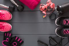 Sport clothing and equipment top view, copy space. Set of new fitness outfit for two, active lifestyle, body care, couple training concept Royalty Free Stock Photography