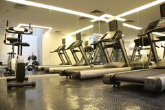 Sport club. Room with gym equipment in the sport club Royalty Free Stock Photos