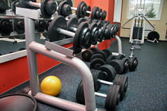 Sport club with ball and dumbbells Stock Images