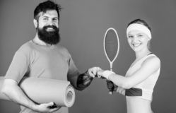 Sport coach. Athletic Success. Sporty couple training with coach. Strong muscles and body. Sport equipment. Happy woman royalty free stock photos