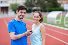 Sport coach training a young attractive woman Royalty Free Stock Photo