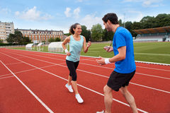 Sport coach training a young attractive woman Royalty Free Stock Photography