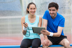 Sport coach training a young attractive woman Royalty Free Stock Photos
