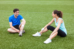 Sport coach training a young attractive woman Stock Images
