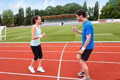 Sport coach training a young attractive woman Stock Photos