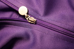 Sport coat zipper. Sport coat details,zipper with purple fabric texture Royalty Free Stock Images