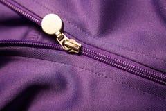 Sport coat zipper. Sport coat details,zipper with purple fabric texture Royalty Free Stock Images
