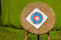 Shooting target and bullseye with many bullet holes Stock Photo