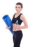Sport concept -beautiful slim sporty woman with yoga mat and wat Royalty Free Stock Photo
