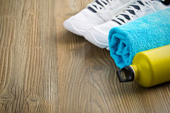 Sport concept. bottle, shoes and towel Royalty Free Stock Images