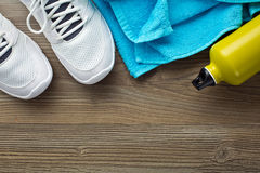 Sport concept. bottle, shoes and towel Stock Images