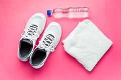 Sport concept. bottle, shoes and towel Royalty Free Stock Photos
