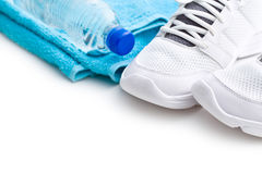 Sport concept. bottle, shoes and towel stock photography