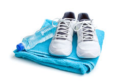 Sport concept. bottle, shoes and towel Royalty Free Stock Photography