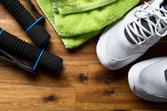 Sport concept. dumbbells, shoes and towel Stock Photos