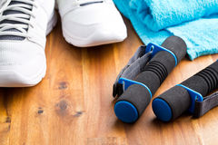 Sport concept. dumbbells, shoes and towel Stock Image