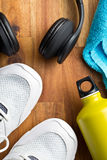 Sport concept. headphones, shoes and bottle Royalty Free Stock Photo