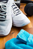 Sport concept. headphones, shoes and towel Royalty Free Stock Photos
