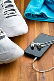 Sport concept. headphones, shoes and towel Stock Photo