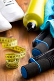 Sport concept. meassuring tape, dumbells and bottle Royalty Free Stock Photography