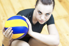 Sport Concept. Photo of a Beautiful Female Volleyball Player With Ball Stock Photo