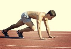 Sport concept. Runner on the start line. Isolated on white royalty free stock images