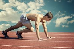 Sport concept. Runner on the start line. royalty free stock images