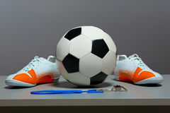 Sport concept - shoes, soccer ball and whistle. Royalty Free Stock Photography