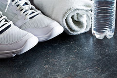 Sport concept. towel, shoes and water in bottle Stock Image