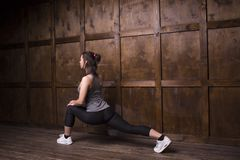 Sport concept - woman doing sports. Active brunette doing athletics home. Sport concept Stock Photos