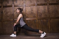 Sport concept - woman doing sports. Sporty woman doing stretching. Wants to be fit Stock Photos