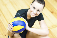 Sport Concept: Young Caucasian Volleyball Player Sitting on Floo Royalty Free Stock Photo