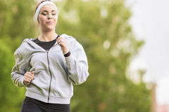 Sport Concept: Young Running Fitness Woman Training Outdoor in t Stock Photography