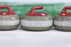 Sport Concepts. Closeup of Curling Blue Handle Stones on Ice. With Copyspace. Horizontal Image Royalty Free Stock Photo
