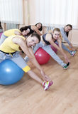 Sport Concepts. Group of Five Female Sportswomen Having Hand Stretching Training Royalty Free Stock Photos